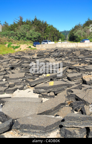 Broken asphalt paving with centerline marker paint visible at the end of Warrenton Cannery Road, Grayland, Washington - Stock Photo