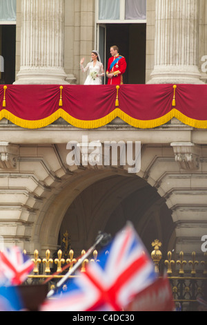 The new Duke and Duchess of Cambridge appear for the crowds on the balcony of Buckingham Palace after their wedding, - Stock Photo