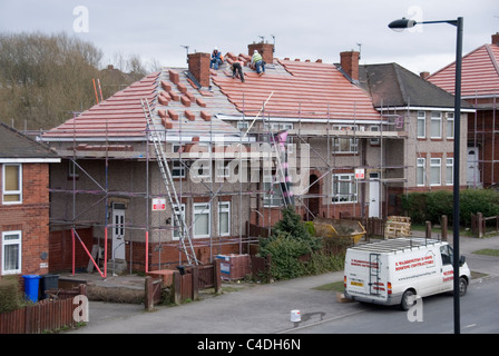 Three Men Laying New Roof Tiles on Three Adjacent Properties, Re Roofing ACIS Properties, Hastilar Road South, Sheffield, - Stock Photo