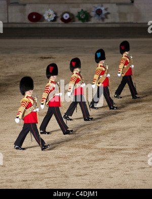 Four drum majors of the British Army Guard regiments march across Horse Guards Parade during the Beating Retreat - Stock Photo