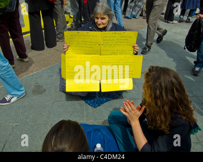 Paris, France, Demonstration Against Nuclear Power, Woman With French Sign Showing to Female Teenagers on Ground - Stock Photo