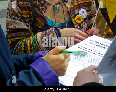 Paris, France, French Demonstration Against Nuclear Power Japanese Women Getting Signatures for Petition, volunteer - Stock Photo