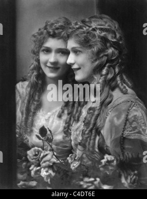 Vintage portrait photo circa 1914 of Canadian-born film actress Mary Pickford (1892 - 1979) standing next to a mirror. - Stock Photo