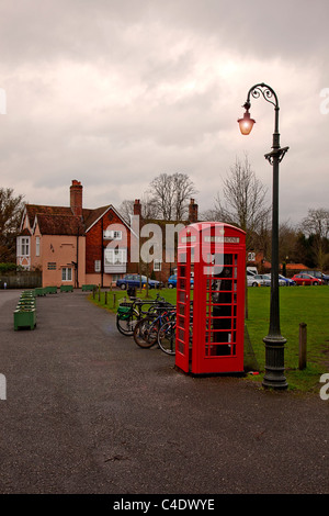 A red K6 telephone box on the Cathedral Green in Salisbury, Wiltshire, England, UK - Stock Photo