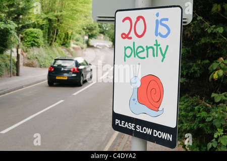 Sign saying: 20 is plenty, please slow down - Stock Photo