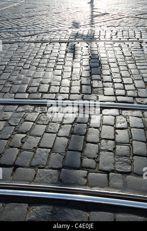 urban shadows on a street in Prague, Czech Republic - Stock Photo