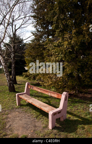 Bench made of wood an concrete in a park. - Stock Photo