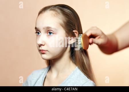 Teen model combing. - Stock Photo