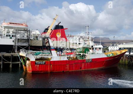 Trawler and car ferry moored at Ullapool, Highland Region, Scotland. - Stock Photo