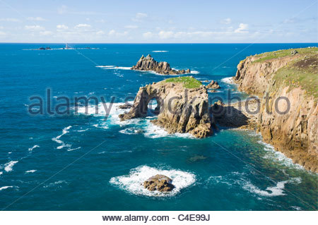 Enys Dodman, The Armed Knight, and the Longships lighthouse at Land's End, Cornwall, England. - Stock Photo