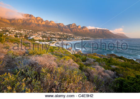 The Twelve Apostles loom over Camps Bay