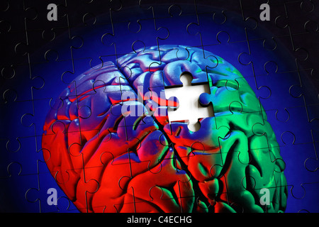 Piece missing from a jigsaw puzzle made from a photo of a human (model) brain. - Stock Photo