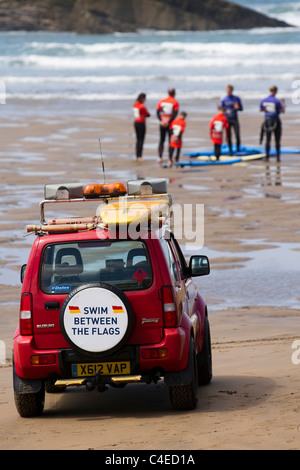 RNLI_ Royal National Lifeboat Institution vehicle, woolacombe bay golden coast _ Surfing lessons on the beach at - Stock Photo