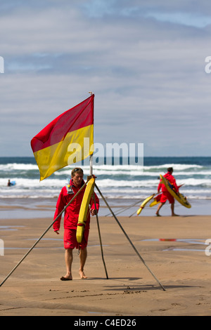 Summerleaze Beach: RNLI Coastguards marking out Safe area with Boundary flags, Flagmarkers on the beach at Summerlease - Stock Photo