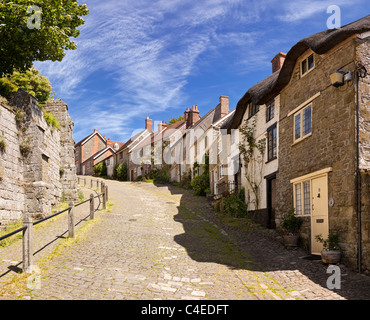 Typical traditional English cobbled street on Gold Hill, Shaftesbury, Dorset, England, UK viewed from bottom of - Stock Photo