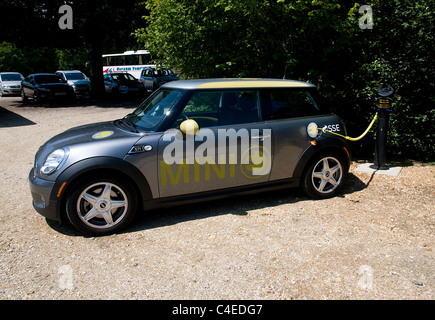 2011 Mini E Electric car at battery charging point - Stock Photo