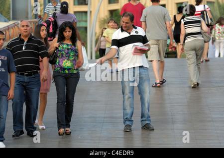 Man Promotes Business on Street - Stock Photo