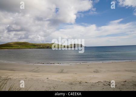 Shetland Islands Scotland May West Voe Beach looking towards Sumburgh Head Lighthouse on tip Southern mainland - Stock Photo