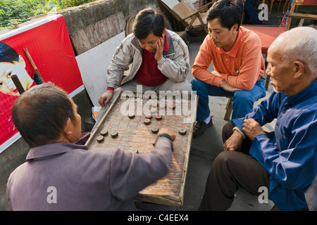 Men playing Chinese chess, near Yangshuo, south of Guilin on the Li River (Li Jiang) - Stock Photo