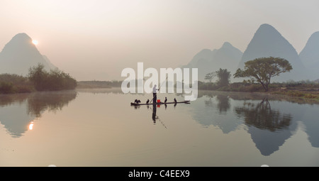 Cormorant fishing on the Yulong River. south of Guilin, Guangxi, China. - Stock Photo