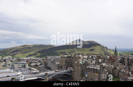 Arthur's Seat and Salisbury Crags in the distance in a view of Edinburgh's Old Town from the top of the Scott Monument - Stock Photo
