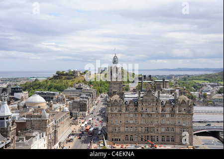 The Balmoral Hotel, Princes Street, Edinburgh, Scotland. In the distance is Calton Hill and the Firth of Forth on - Stock Photo