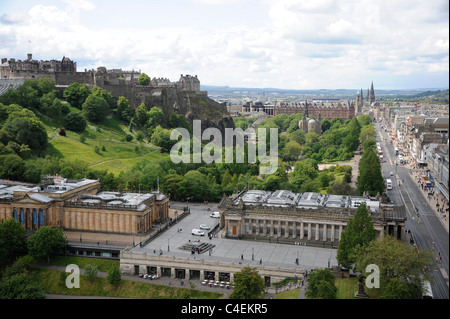 Edinburgh Castle, looking west along Princes Street with the National Galleries  (sandy coloured)  and the RSA in - Stock Photo