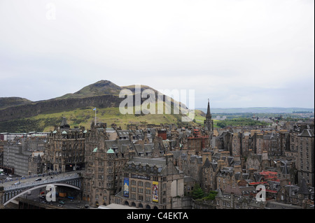 A view of Edinburgh's Oldtown on the Southside of the city with Arthur's Seat and Salisbury Crags in the distance - Stock Photo