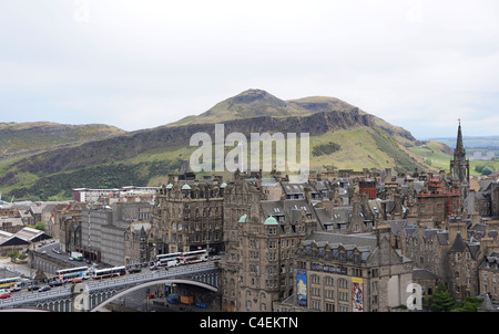 A view of Edinburgh's Oldtown with The Scotsman Hotel in the centre and the 823 feet high Arthur's Seat in the background - Stock Photo