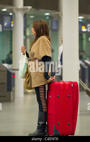 woman with luggage - Stock Photo