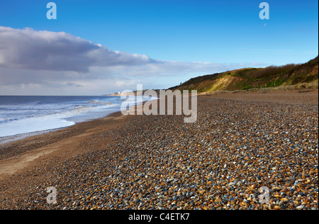 The beach at Dunwich on a spring morning looking towards Sizewell with Sizewell Nuclear Power Station in the distance - Stock Photo
