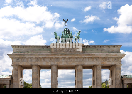 Brandenburger Tor in Berlin. Nice view with bright blue sky and some clouds. Brandenburg Gate - Stock Photo