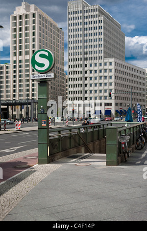 Capture of the city life at the Potsdamer Platz in Berlin, Germany. View to the Beisheim Center with the Ritz Carlton - Stock Photo
