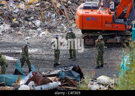 Japan ground self defense force is to start working at an area where devastated by tsunami Ishinomaki city Miyagi - Stock Photo