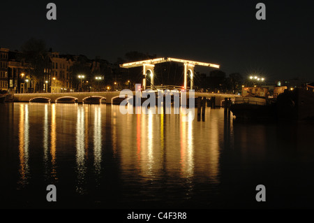 skinny bridge magere brug reflecting in the river amstel at night stock photo royalty free. Black Bedroom Furniture Sets. Home Design Ideas