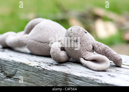 Child's Toy Rabbit, Attachment Object, as part of childhood, and transitioning away from parents. - Stock Photo