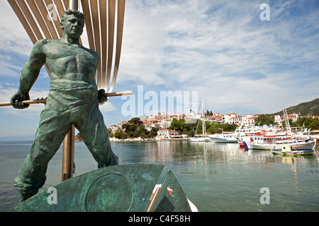 monument of the Unknown Sailor and the old harbour in Skiathos town, Skiathos Island, Northern Sporades, Greece - Stock Photo