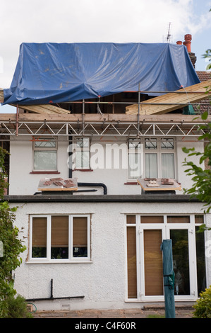 A loft attic room being built on a semi detached house in London - Stock Photo