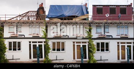 Three stages showing a loft attic room being built on a semi detached house in London - Stock Photo