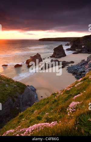 Sunset over Bedruthan Steps, North Cornwall, England. Spring (May) 2009. - Stock Photo