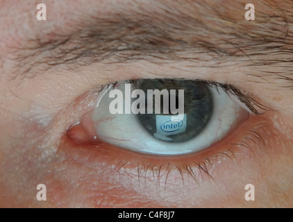Company Logo mirrored in Eye - Stock Photo