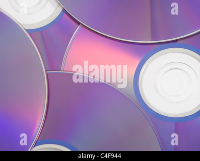 Stack of Blank DVDs Closeup Piled Up - Stock Photo