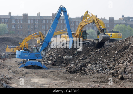 Earth movers working at the demolition site of the former Fountainbridge Brewery, Edinburgh - Stock Photo