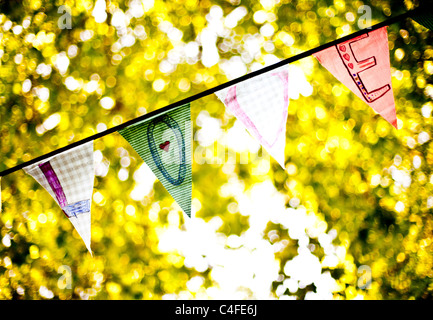 A line of bunting flags spelling 'Love' - Stock Photo
