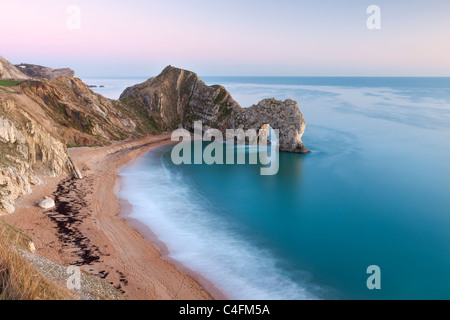 Deserted beach at twilight, Durdle Door, Dorset, England. Winter (January) 2011. - Stock Photo