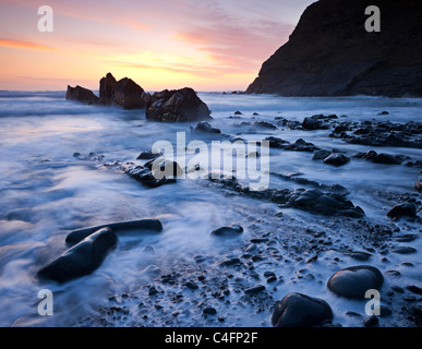 High tide on Duckpool beach at sunset, North Cornwall, England. Spring (March) 2011. - Stock Photo