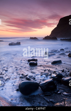 Twilight on the rocky beach at Duckpool on the North Cornish Coastline, Cornwall, England. Spring (March) 2011. - Stock Photo