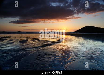 Sunset on Newgale Beach, Pembrokeshire, South Wales - Stock Photo
