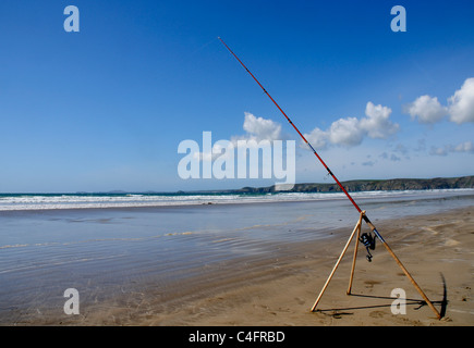A sea fishing rod on Newgale beach in Pembrokeshire, Wales - Stock Photo