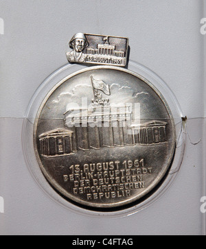 An East German medal awarded  to the men who built the Berlin Wall on August 13 1961 - Stock Photo